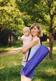 Mother and her daugther. Mother and her daughter going for yoga class Royalty Free Stock Images