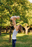 Mother and her daugther. Mother and her daughter are practice yoga Stock Image