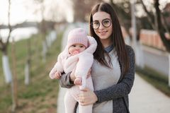 Mother with her four month baby girl outside. Happy family stock photos