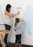 Mother and her girl decorating a room Royalty Free Stock Photo