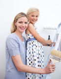 Mother and her girl painting a room Royalty Free Stock Photo