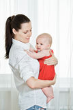 Mother with her happy child on arms Royalty Free Stock Images