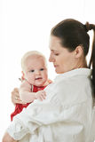 Mother with her happy child on arms Royalty Free Stock Photos