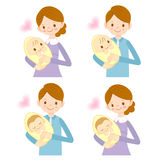 The mother and her husband holding the baby. Marriage and Parent Stock Photos