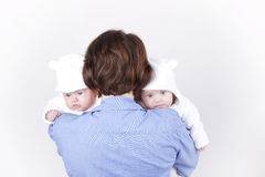 Mother and her identical twin daughters Stock Image