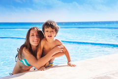 Mother and her kid hugging with sea on background Stock Image