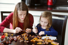 Mother and her kid making chestnuts creatures Royalty Free Stock Photography