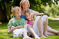 Mother and her kids royalty free stock photography