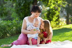 Mother and her kids outdoors. Happy mum and her children playing Royalty Free Stock Images