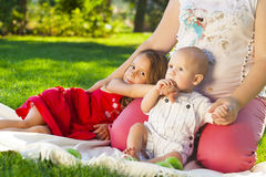 Mother And her kids outdoors. Happy mum and her children playing Royalty Free Stock Photo