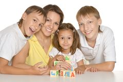 Mother and her kids playing with cubes Stock Photo
