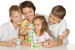 Mother and her kids playing Stock Photo
