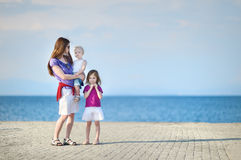 Mother and her kids by a sea Royalty Free Stock Photography