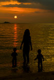 Mother and her kids silhouettes Stock Photo