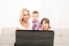Mother with her Kids using a Laptop computer Stock Images