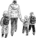 Mother with her kids on a walk Royalty Free Stock Photo