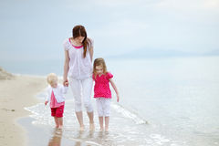 Mother and her kids walking along a beach Royalty Free Stock Photography