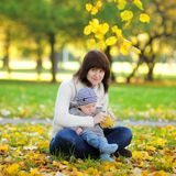 Mother with her little baby boy in the autumn park Stock Photography