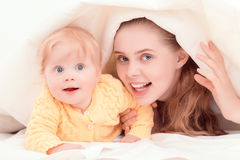 Mother and her  little baby playing Royalty Free Stock Images