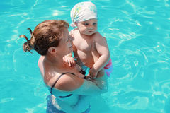 Mother and her little baby swim Stock Images