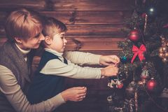 Mother and her little boy decorating christmas tree Royalty Free Stock Photo