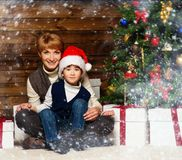 Mother and her lIttle boy in Santa hat Stock Images