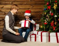 Mother and her lIttle boy in Santa hat Royalty Free Stock Image