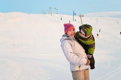 Mother and her little child on ski slope Royalty Free Stock Photography