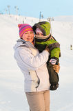 Mother and her little child on ski slope Royalty Free Stock Images