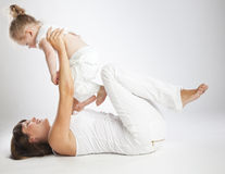Mother and her little  daughter. Mother and her little daughter. Gray background Stock Photography