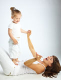 Mother and her little  daughter. Mother and her little daughter. Gray background Royalty Free Stock Photo