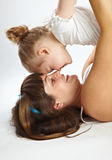 Mother and her little  daughter. Mother and her little daughter. Gray background Royalty Free Stock Photography