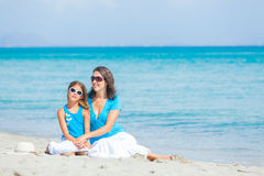 Mother and her little daughter on beach Stock Photo