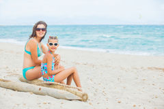 Mother and her little daughter on beach Stock Photos