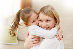 Mother and her little daughter child girl playing and hugging. stock photo