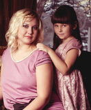 Mother and her little daughter embracing Stock Images