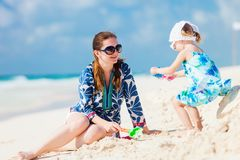 Mother and daughter on vacation. Mother and her little daughter enjoying Caribbean beach vacation stock images