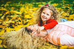 Mother with her little daughter have fun in the park. royalty free stock photography