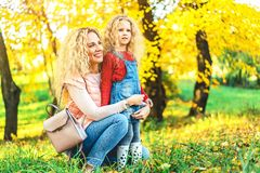 Mother with her little daughter have fun in the park. stock images