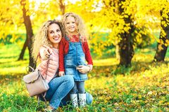 Mother with her little daughter have fun in the park. royalty free stock images