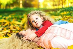 Mother with her little daughter have fun in the park. royalty free stock image