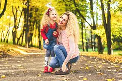 Mother with her little daughter have fun in the park. stock photography
