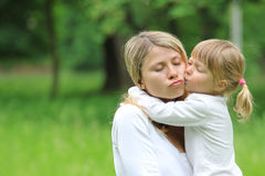 Mother and her little daughter on nature Royalty Free Stock Image