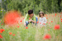 Mother with her little daughter in poppy field Royalty Free Stock Images