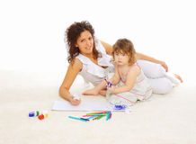 Mother and her little daughter spend time together Stock Photo
