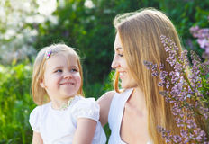 Mother and her little daughter in the spring day Stock Images
