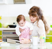 Mother and her little daughter with tablet pc Royalty Free Stock Photo