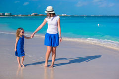 Mother and her little daughter at tropical beach Stock Photos