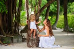 Mother and her little daughter in tropical park Royalty Free Stock Images