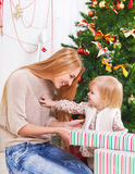 Mother with her little daughter under the Christma Stock Photo